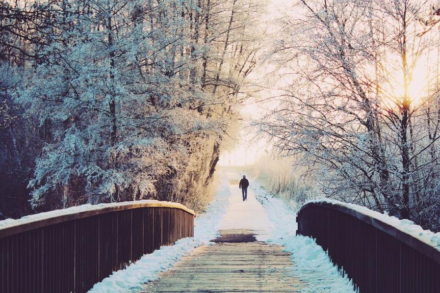 distant-man-on-a-snowy-lane